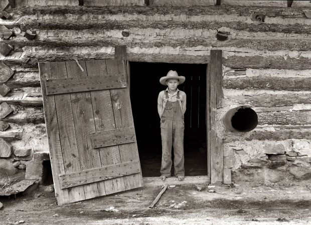 Farm Boy: 1939 Farm boy in the doorway of a tobacco barn, Person County, North Carolina.