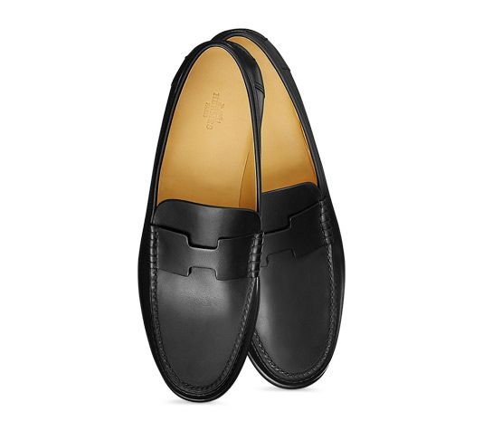 DISCREETLY UNDERSTATED: Hermes men's moccasin in black calfskin, hand-sewn upper, blake stitched leather sole
