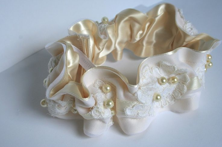 Garter made from mother's wedding dress. Love this idea. And I want to either wear her dress and have it altered or use the lace from it.