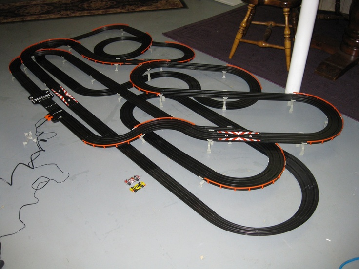Testing my Tomy AFX Giant slot car race set on the basement floor.  With this set and the Tomy Super International Race Set you will have enough track to build the 4 Way Challenge.