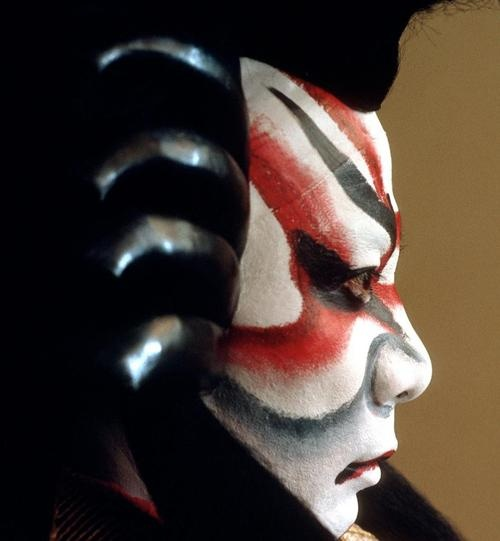 """Japan. Kabuki makeup. One of the most signifying traits of kabuki is the makeup. Colors painted on faces represent emotion. """"…red lines are used to indicate passion, heroism, righteousness, and other positive traits; blue or black, villainy, jealousy, and other negative traits; green, the supernatural; and purple, nobility."""" –Wikipedia"""