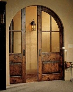 Arched pocket doors ... lovely!  Replace French doors flanking fireplace?