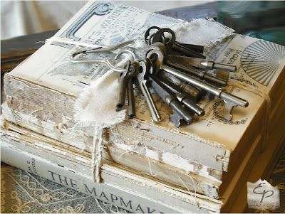 Old skeleton keys tied to shabby books.