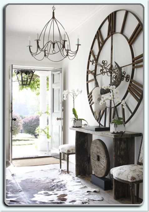 ok . . .this clock might be big enough!  and the old table and wheel.....I'm in!