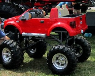 Monster truck Wagon. O HELL YEA! Start em young!
