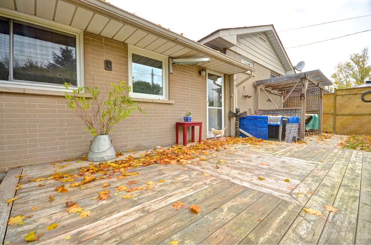 Walk out from the kitchen to the beautiful back yard with garage access, a patio, and charming pergola on the deck.  #Orangeville #OrangevilleOntario #OrangevilleRealEstate