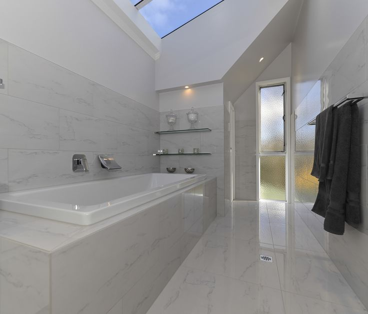 If space is available, having a display area at the end of the bath is interesting