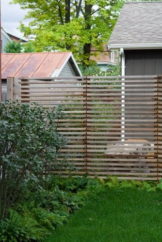 A slated wood fence is ideal for backyards, as these fences both enclose and define a space as well as provide some privacy. It's suitable for any style, from colonial to contemporary