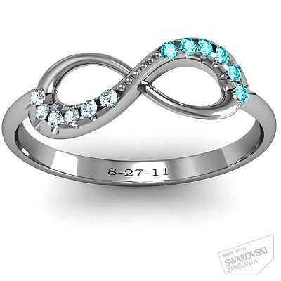 Infinity Ring with his and hers birthstones, and engraving. Love it.