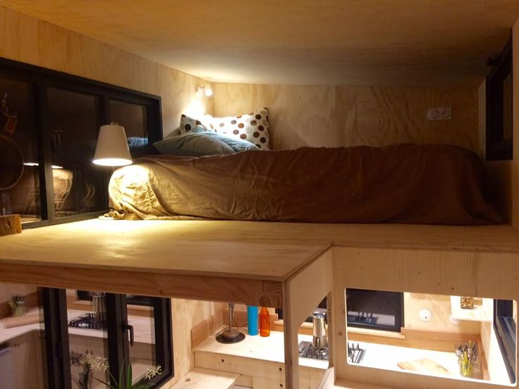 This is the Christine Model by La Tiny House in France. It's about 19.5 ft. long and features two lofts, one of which is accessible by some cool floating bookshelf stairs. The best part of th…