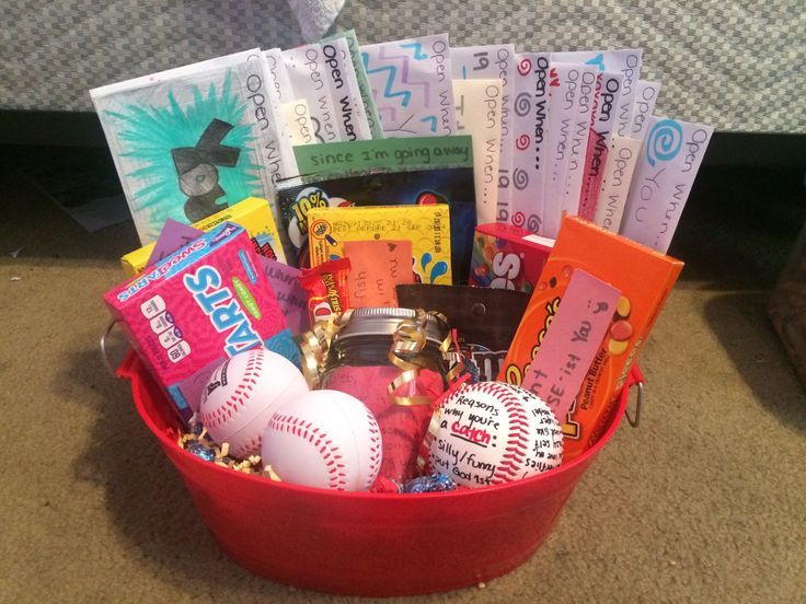 Baseball boyfriend gift to give before going off to different colleges: reasons why I love you jar, reasons why your a catch ball, candy with cute messages, open when letters, & stress baseballs to add a little extra. #Boyfriend #Baseball #GiftIdeas
