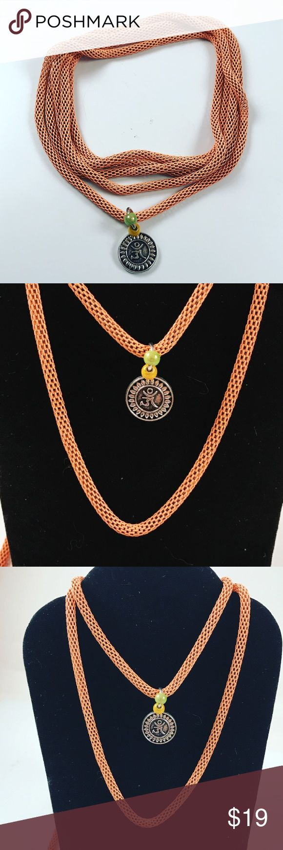 Women orange wrap around necklace and om sign Women wrap around necklace. Handmade by me , never worn by anyone. Necklace is 46 inch long . Wear it in layers , wrap around. Pastel orange cable necklace. Tibetan silver om sign . I ship fast !!😊✈️😉 Jewelry Necklaces
