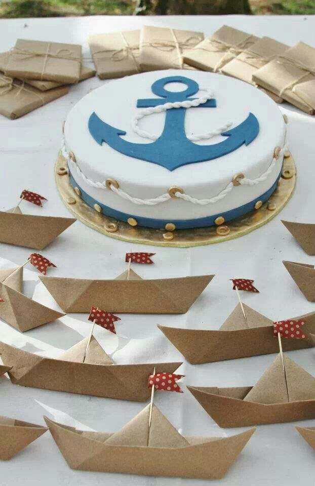 I like the rope accent on the cake. I like the little paper origami boats too.