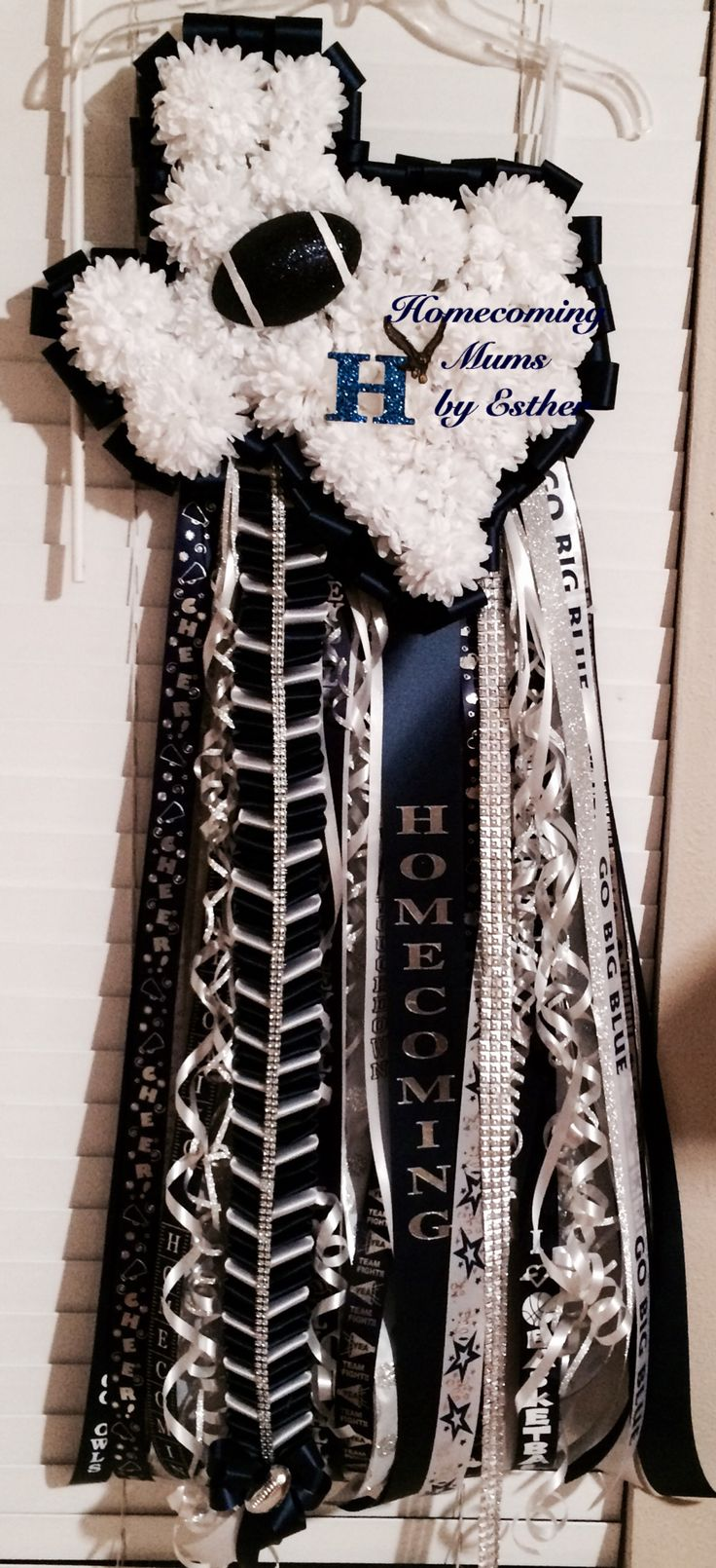 Texas shape homecoming mum navy and white with ribbons galore