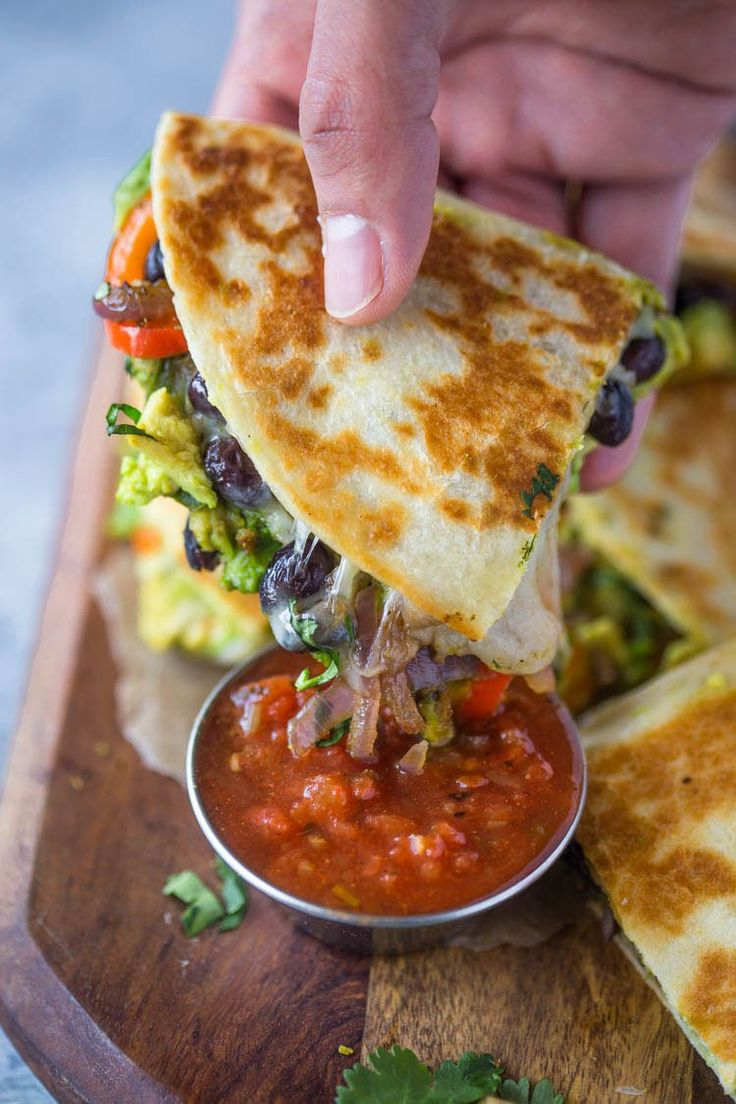 Crispy quesadillas filled with beans, sautéed onions, bell pepper, avocado and lots of cheese. These avocado black bean quesadillas are filling and make a great vegetarian meal too!  Happy New Year…