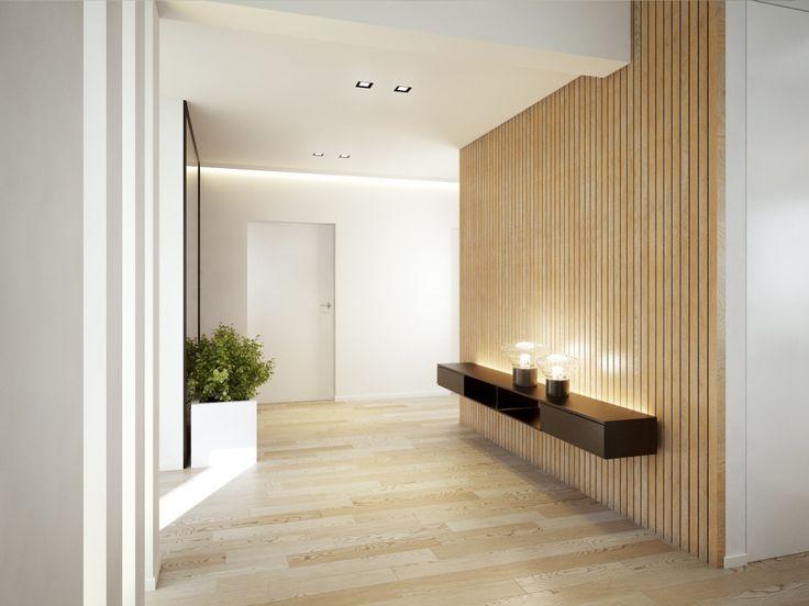 Pomysł na aranżację długiej sciany w korytarzu. Efekt deskowania podkreślają lampy o ciekawej formie i ciepłym odcieniu światła