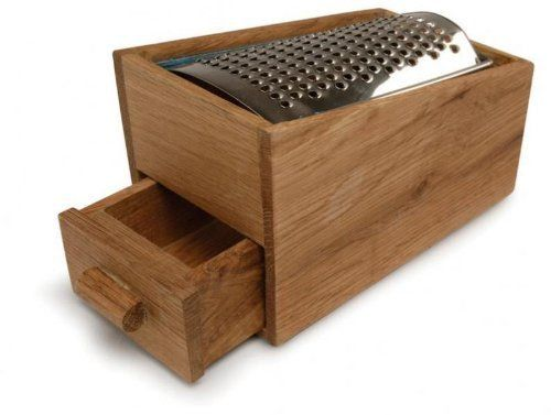 Sagaform Stainless Steel Cheese Grater with Oak Cheese Catcher by Sagaform. $19.95. Grate directly into the wooden bo by  with drawer. Stainless steel grater and oak bo by. Measures: 5 1/2-inch  by  3 3/8-inch  by  3 1/2-inch. Stainless steel cheese grater with wooden bo by. Stylish and functional this stainless steel cheese grater with wooden bo by  will become a favorite. Grate your cheese directly into the wooden bo by  and then pull the drawer out to retreive your cheese. ...