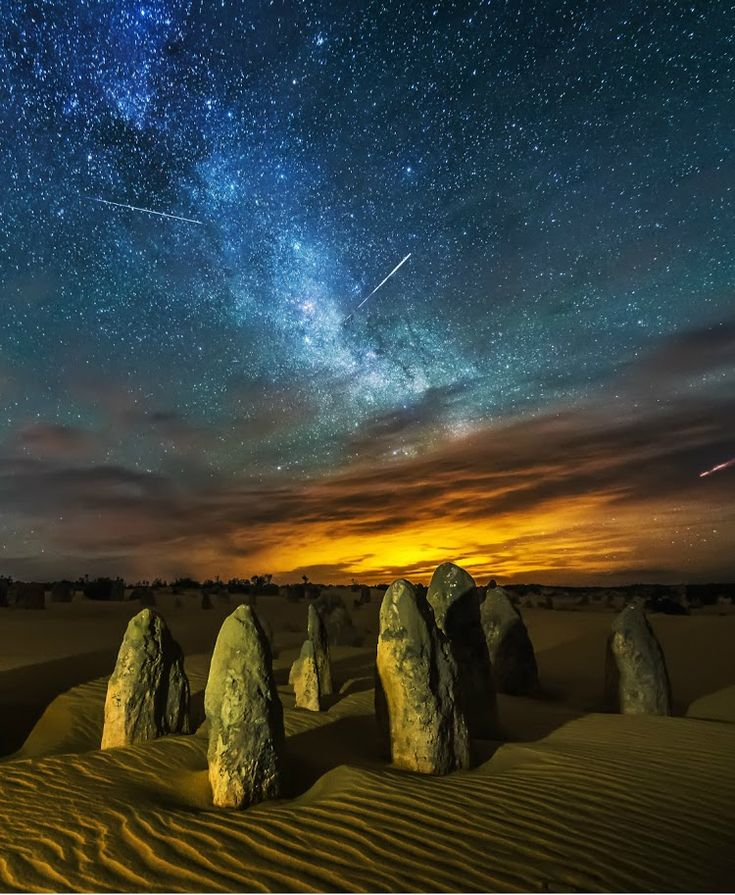 Meteor Shower, Pinnacles, Western Australia... by Yifan Bai The Pinnacles are limestone formations contained within Nambung National Park, near the town of Cervantes, Western Australia. The raw material for the limestone of the Pinnacles came from seashells in an earlier era that was rich in marine life. These shells were broken down into lime-rich sands that were blown inland to form high mobile dunes