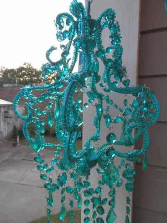 Teal chandelier. I don't know...I kinda like this....in the right room, right design.