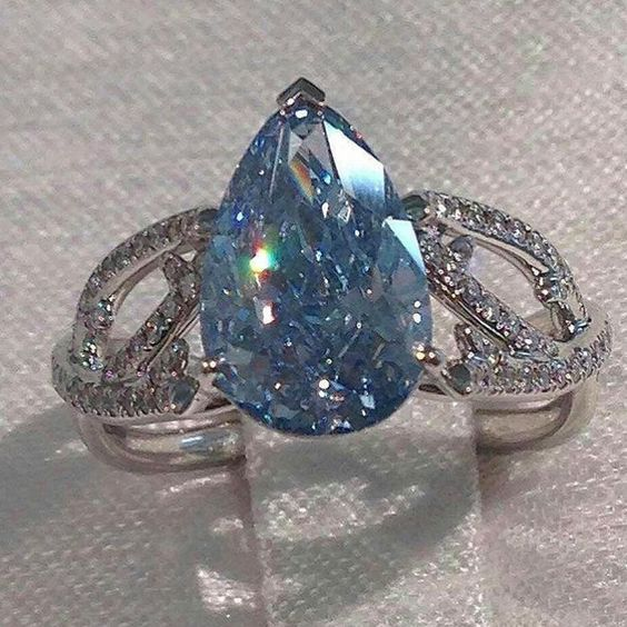 De Beers. Blue diamond ring