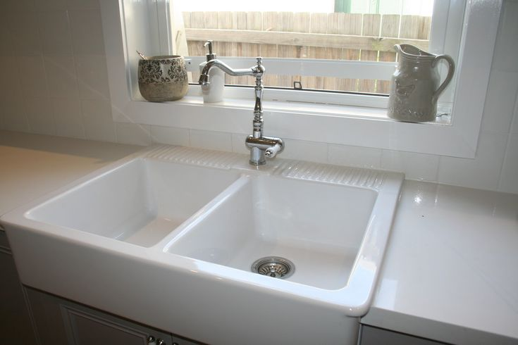 It's a double bowled farm sink, also called an apron sink, meaning