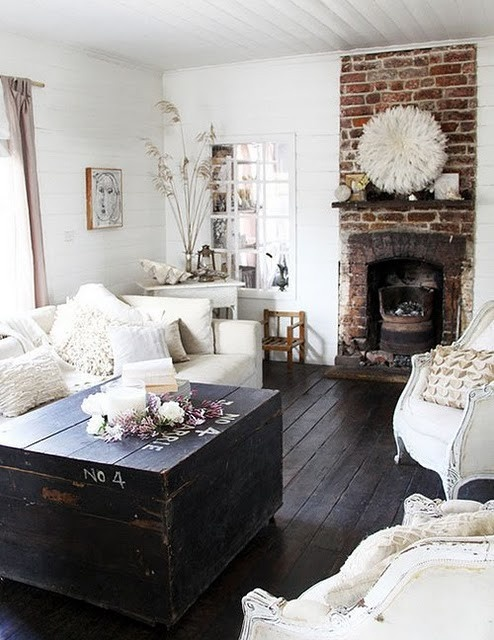 So rustic, I love it, especially the floors, the brick & the trunk as coffee table