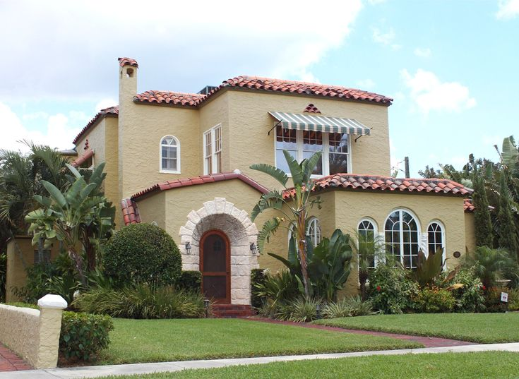 Exquisite Mediteranian Exterior House Design With Curved Entry Door Frames As Well Green Gardening Front Mediterranean