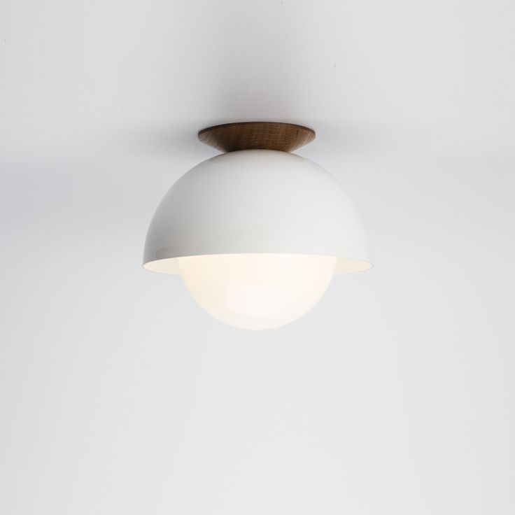 Flush Dome white ceiling light with ealnut trim. Mid century midern look