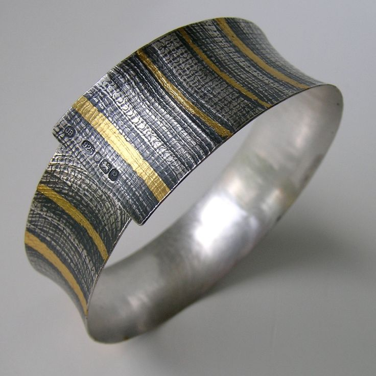 Oxidised silver cuff with gold leaf by Jessica Briggs