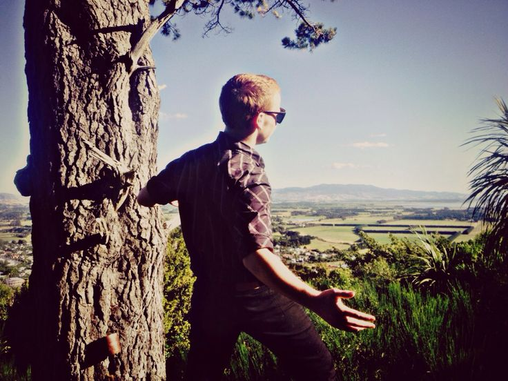 Jordan leaning back while standing on one tree hill