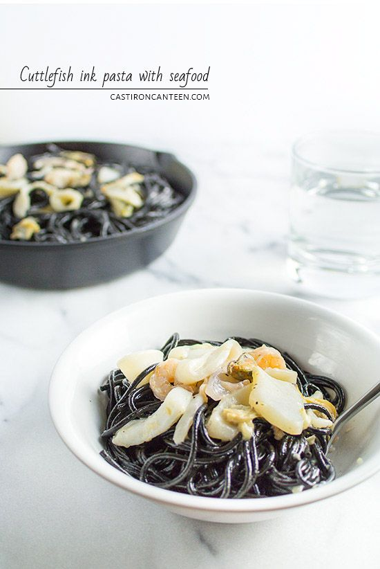 Cuttlefish ink pasta with seafood (spaghetti al nero di sepia). Sauce with heavy cream, white wine and parmesan. Frozen seafood medley is ok.