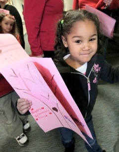 Association preschooler Jaylee Smith carries valentine she made for residents of Gino Merli Veterans Center.    Read more: http://thetimes-tribune.com/news/toddlers-hand-deliver-valentines-to-veterans-1.1271514#ixzz1mN3W5jaS