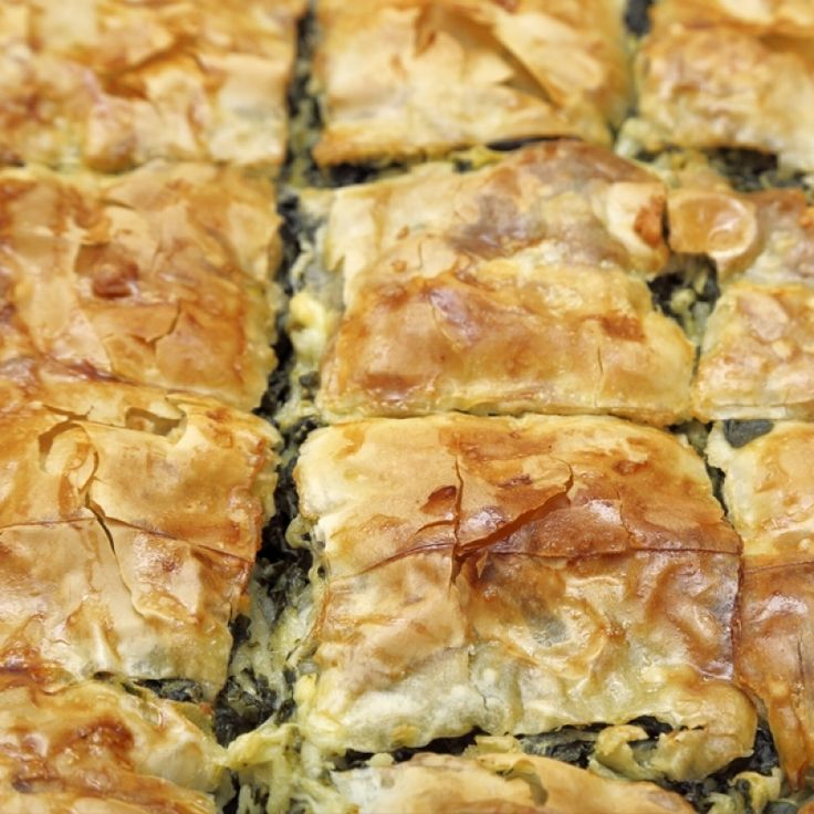 A very flavorful recipe for light and crispy spinach filo pie, also called Spanakopita.. Spinach Filo Pie Recipe from Grandmothers Kitchen.