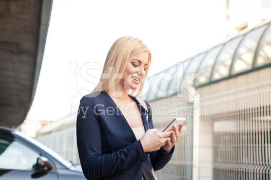 Woman holding smartphone royalty-free stock photo