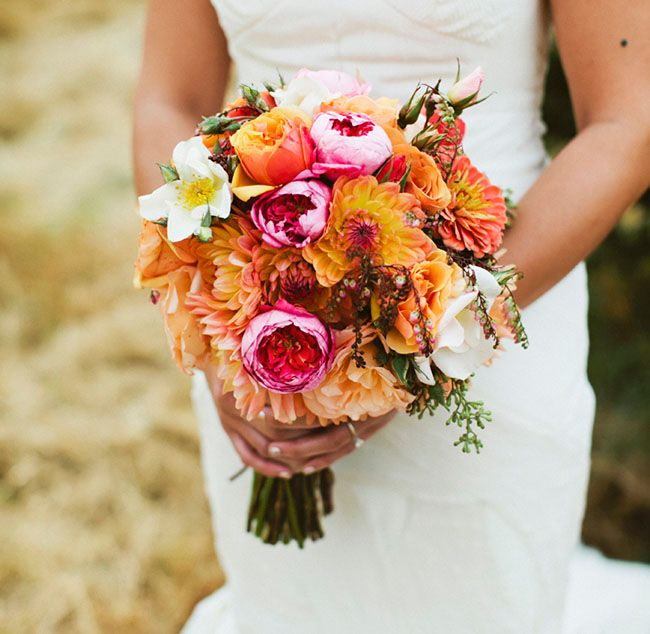 the brightest most beautiful wedding bouquet! Love the orange and pink!