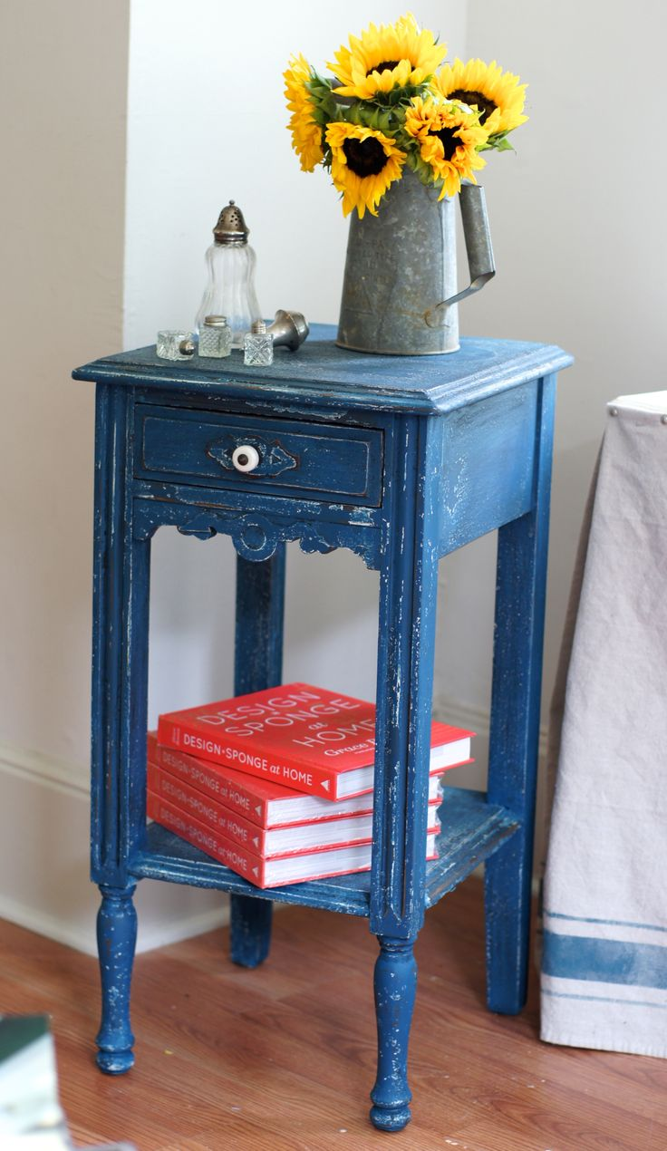 another view of our favorite miss mustard seed's flow blue table...a little linen underneath the blue, and antiquing wax on top.