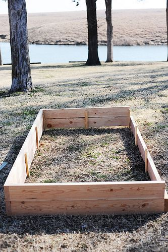 A step-by-step tutorial on how to make a raised garden bed. We're gonna have to do this!!