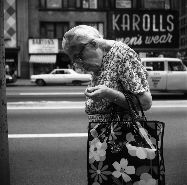 Vivian Maier, Chicago (Woman Hunched with Floral Bag), 1972.