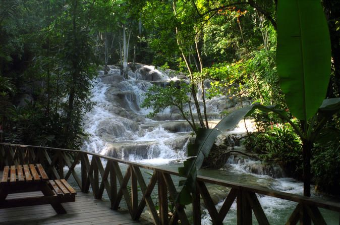 Dunn's River Falls and Ocho Rios Shopping Tour from Runaway Bay Enjoy this Ocho Rios day-trip that includes pick up at your resort lobby for a breathtaking day trip to Dunn's River Falls, Ocho Rios shopping and lunch at Scotchies Outdoor Garden Restaurant.Your friendly, professional tour guide will meet you at your Runaway Bay hotel where you will board a clean, air-conditioned bus. While on the bus you will hear tons of information about the beautiful island of Jamaica. Now y...