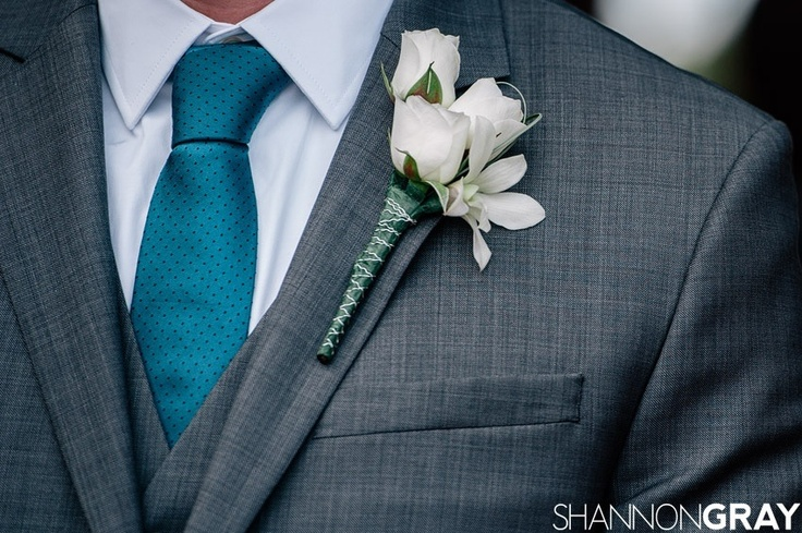 Great combination of pin-dot tie in teal, and stone gray 3-piece suit.