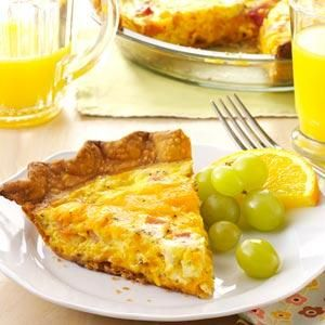 Ham 'n' Cheese Quiche Recipe -When I was expecting our daughter, I made and froze these cheesy quiches as well as several other dishes. After her birth, it was nice to have dinner in the freezer when my husband and I were too tired to cook. —Christena Palmer, Green River, Wyoming