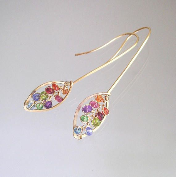 ......delicate....feminine....shapely.... Made to order with a seven to ten day turnaround. 20 gauge 14k gold filled wire lengths have been forged into leaf or petal shaped earrings with elongated ear hooks. Tiny vines of orange and red sapphires, pink sapphire, red spinel, amethyst,