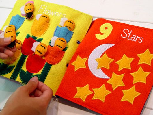 This post is about textile books for baby - why and how.  Accompanying the pictures are from firmenich brands that make the book interactive...