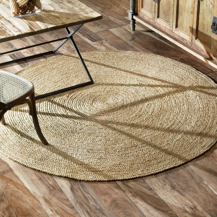 Decorate in eco-friendly style with this beautiful hand-crafted jute rug made by artisans from hand-spun, sustainably harvested jute brained and wound into a spiral. With a silky shine, this durable, reversible fiber rug is great for high-traffic areas.