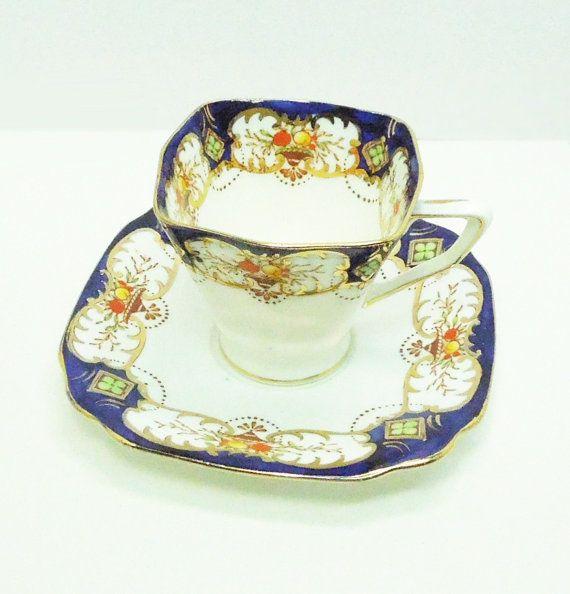 Standard China Stuart Shape tea cup saucer set with cobalt blue and gold trim green clovers in golden diamonds - Reg number 768534