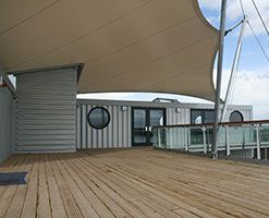 a marketing suite, with awesome sail awningSailing Awning, Commerici Design, Outdoor Living, Bark Riverside, Awesome Sailing, Pedro Soar, Conteiner House, Marketing Suits, Riverside Marketing
