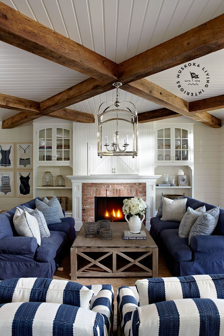 Exposed beams  white ceilings a must in the cabin-love the idea of framed vintage bathing suits too
