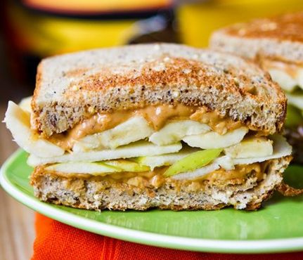 peanut butter,apple and banana sandwich on wheat bread