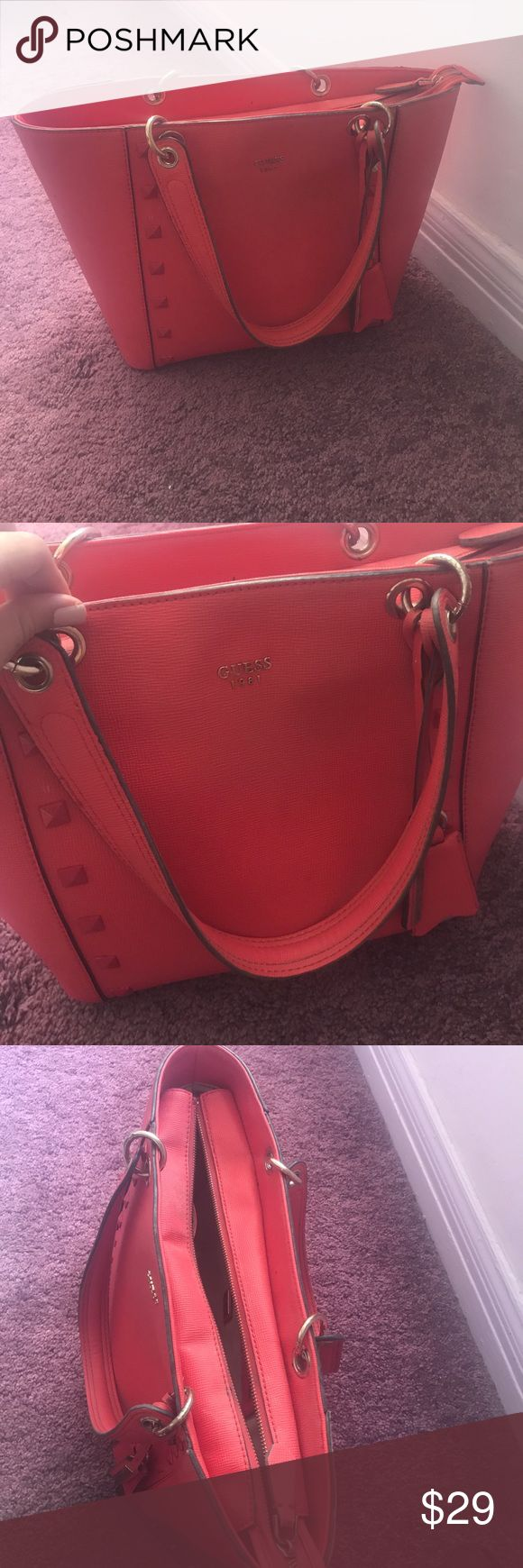 """Guess Kamryn Extra-Large Tote in Lipstick Red Extra large sized bag: 16-1/2""""W x 10-1/2""""H x 6""""D. 8-3/4""""L double handles. Zip closure. Exterior features 1 zip pocket, logo &a charm. 1 interior zip pocket & 3 slip pockets. Laptop compatible (std. size 13"""" - 15""""). Faux Leather. Note: inside is dirty (as shown in last picture) and needs to be cleaned. Guess Bags Totes"""