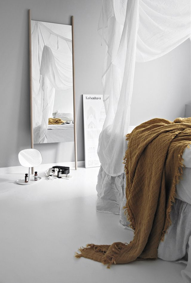 Light grey, white and mustard yellow in the bedroom of Katerina Dima.
